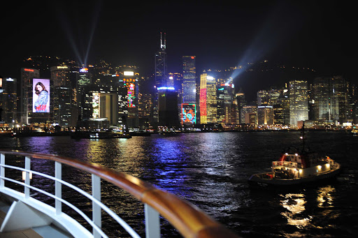 Enjoy the brilliantly lit skyline of Hong Kong on a Ponant cruise.