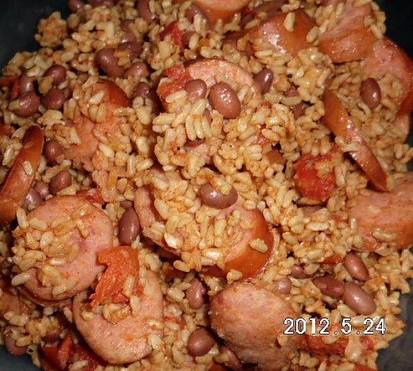 SAUSAGE OPTION:In a large skillet place sausage slices and brown.  Add drained and...