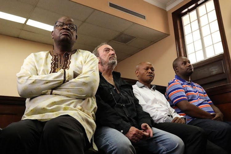 Mangope France Hlakudi, Antonio Jose Da Costa Trindade, Abram Abei Masango and Maphoko Hudson Kgomoeswana appear at the Johannesburg magistrate's court for their formal bail application on December 19 2019.