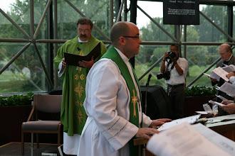 Photo: Rev. Golden read the Holy Gospel from Matthew 28:16-20.
