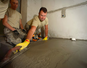 Photo: U.S. Air Force Master Sgt. Winston Kettle, 133rd Civil Engineering Squadron, levels a concrete floor at an elementary school in Ogulin, Croatia, June 25, 2014. The school bathrooms are being renovated by Airmen from the 133rd and 148th Civil Engineering Squadron, and 219th Red Horse Squadron in partnership with the Croatian Army. Croatia is a Minnesota State Partner under the National Guard State Partnership Program. (U.S. Air National Guard photo by Staff Sgt. Austen Adriaens/Released)