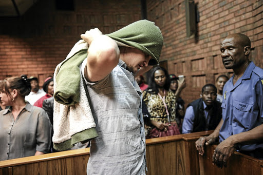 Dros restaurant rape accused Nicholas Ninow leaves the courtroom following his appearance in the Pretoria magistrate's court on November 1.