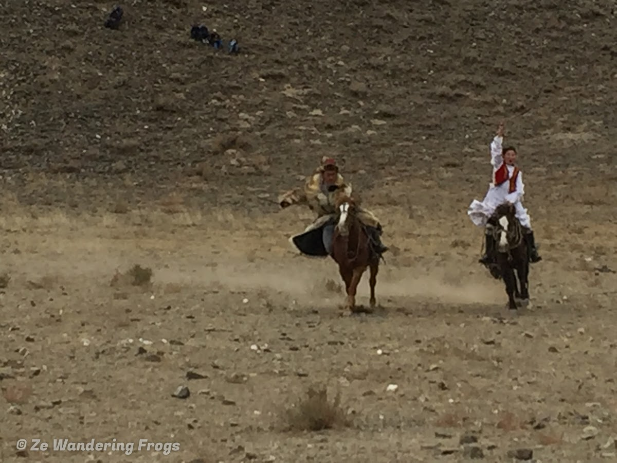 Mongolia. Golden Eagle Festival Olgii. Kyz Kuar - Girls Chasing and Whipping Boys
