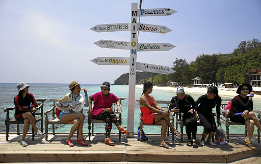 Fun in the sun: Tourists wait for their boat at Maiton Island in Phuket, Thailand, in 2016. With its palm-fringed beaches, Buddhist culture and racy nightlife, Thailand has been the poster child for Asian tourism for decades. It is now targeting gay tourists as a lucrative market. Picture: REUTERS
