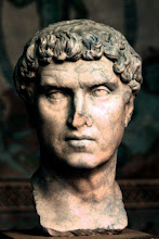 Photo: This man is T. Caesernius Statianus, of the House of Caesernii from Aquileia, northern Italy. He belonged to the closer circle of emperor Hadrianus and most likely to his entourage on the emperor's travels. In 150 A.D., under Antoninus Pius, Statianus was provincial governor in Mogontiacum, a few kilometres from my native place.  In the company of emperor Hadrianus, Caesernius Statianus must also have been acquainted with Princess Iulia Balbilla of Commagene, a close friend of empress Sabina, who left several poetic graffiti in Egypt. This acquaintance is an important plot element in our historical novel series (http://www.corpus-sacrum.de) where both get involved in the death of Hadrian's favourite, Antinous. Later, during his time as governor in Mogontiacum, he is looking in vain for the last surviving sibling of the Antikythera Mechanism that for good reasons he is suspecting very close nearby.  A lesser branch of the Caesernii dwelt in Colonia Iulia Emona, modern Ljubljana, which is attested by several gravestones. For the purposes of our narrative, we have assumed that the unidentified golden statue presented earlier, known as the Emonian, depicts a member of the Caesernii of Emona.  The bust of T. Caesernius Statianus is on display in the Glyptothek in Munich, Germany.
