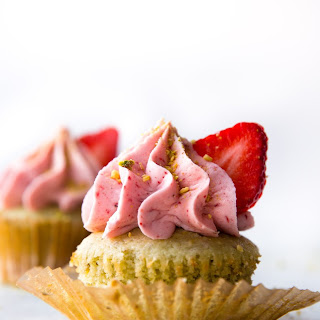 Pistachio Cupcakes with Creamy Strawberry Frosting.