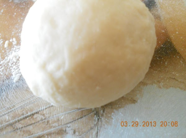Dust some flour, if the dough feels sticky, turn it onto a  floured...