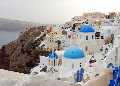 santorini-buildings-1.jpg - Houses and churches in the traditional colors of the Cyclades on Santorini, Greece.