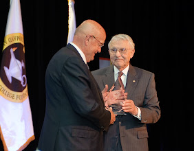 Photo: Arter presents the crystal for the CGSC Foundation 2009 Distinguished Leadership award to Gen. Sullivan.