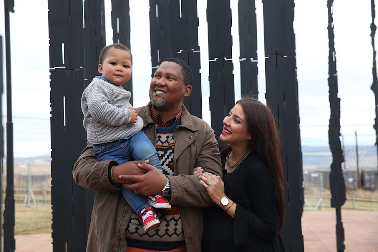 Nelson Mandela's grandson Nkosi Zwelivelile Mandla Mandela with his son Mandela Ikraam Mandela, 15 months, and wife Nosekeni Rabia Mandela, who is 5 months pregnant with their second child, at the Mandela Capture Site in Howick. The site was the finish of the Mandela Day Marathon where the family walked the 10km race together for the centenary of Nelson Mandela.