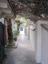 Photo: Villa Royale walkway leading from one patio to another