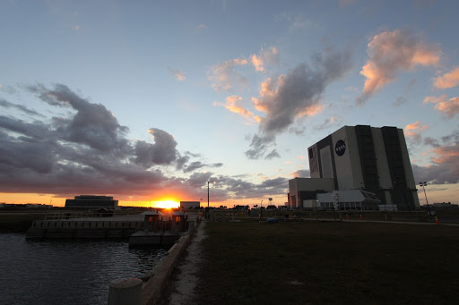From the Turn Basin at NASA's Kennedy Space Center in Florida the sun sets over the Launch Complex 39 area.
