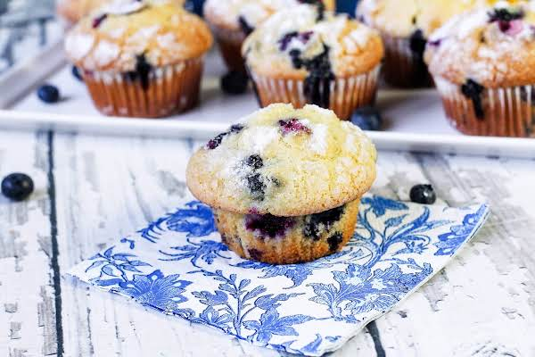 An Ultimate Blueberry Muffin On A Napkin.