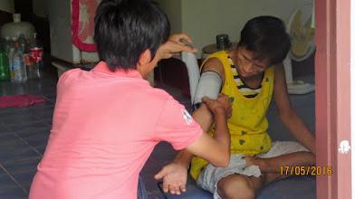 Photo: Mae Ai Arm checks blood pressure of HIV patient.