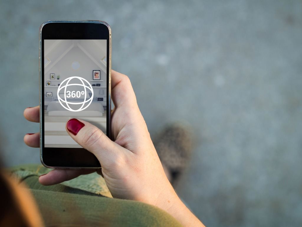 woman's hand on iphone with 360 icon on image