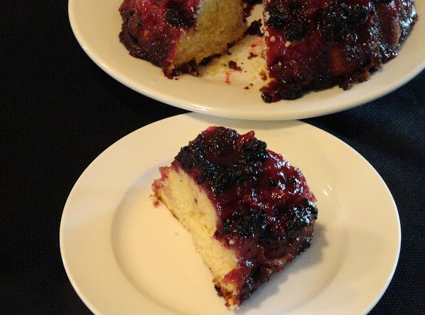 Garnish the serving plate with a few blackberries and fill the hole of the...