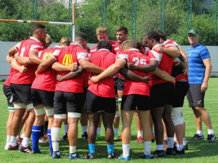 Junior Springbok coach Chean Roux watches on as the forwards are in a huddle during the Junior Springboks training at Lelo Arena on June 06, 2017 in Tbilisi, Georgia.