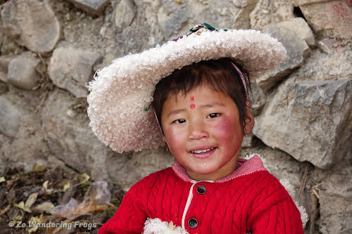 China Sichuan Kham Tibet Garze Ganzi Kandze Monastery Buddhist Festival // Little Girl Dressed Up for the Festival