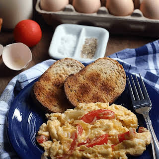 Onion and Tomato Scrambled Eggs Made with Healthy Options All-Natural Eggs.
