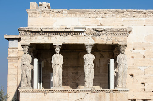 Statues line the  Erechtheion, or Temple of Athena, built in 421-406 BC at the Acropolis in Athens.