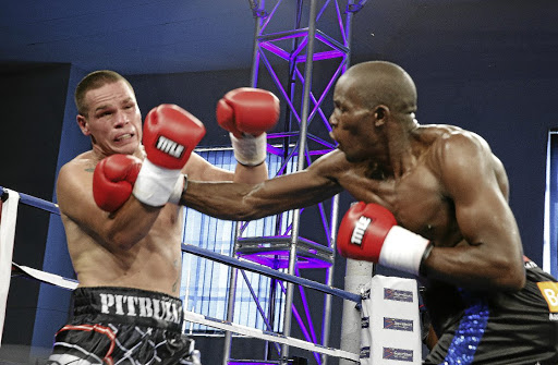 Walter Dlamini on his way to knock out 22-year-old Frank 'Pitbull' Rodriguez in the second round of their 10-rounder at KwaThema Community Hall in Springs, on the East Rand, on Sunday./nick lourens