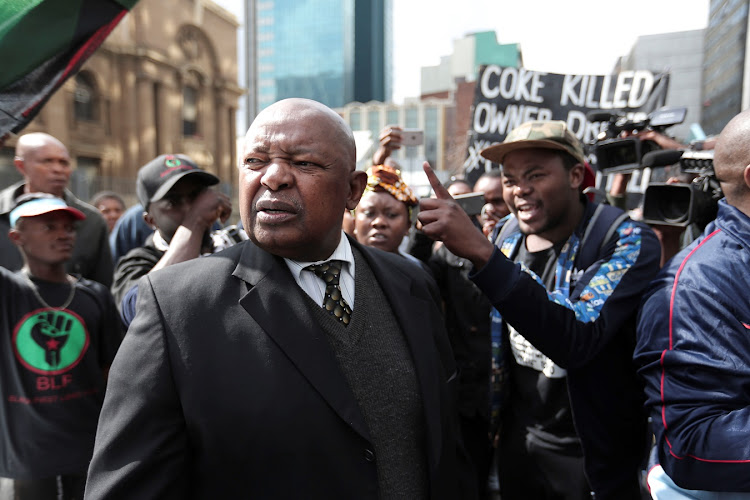 Mosiuoa (Terror) Lekota surrounded by BLF supporters outside the High Court in Johannesburg.