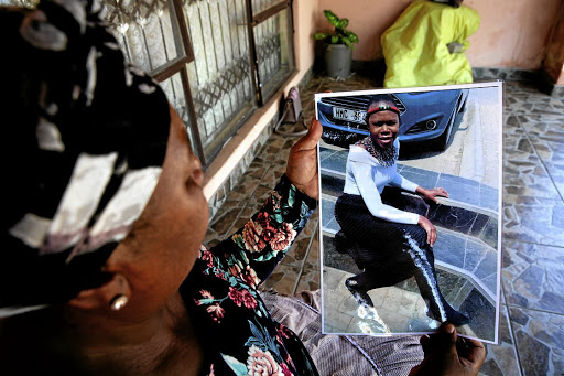In mourning: Clacy Sekome holds a picture of her daughter Gloria, a victim of GBV. Picture: Supplied