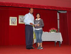 Photo: Kishanti Ponampalam receiving the excellence Award. She did well in PSLE.