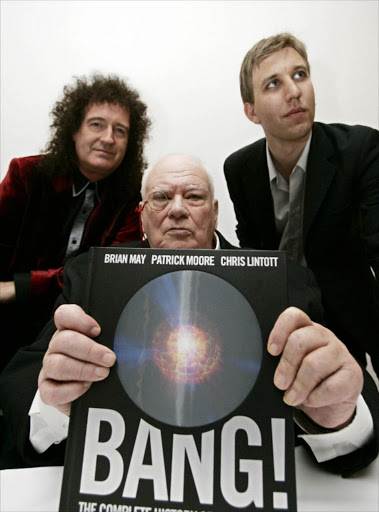 Brian May, (L) guitarist for rock band Queen, joins astronomer Sir Patrick Moore (C) and Chris Lintott during a photocall to launch their book on the history of the universe, entitled 'Bang! The Complete History of the Universe' in central London, 23 October 2006.