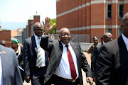 Former president Jacob Zuma leaves the Pietermaritzburg High Court to address his supporters after court proceedings against him on November 30 2018.