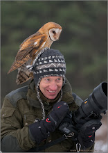 Photo: My friend Greg and a Barn Owl!  (I accidentally deleted the first post!)  Greg Gulbransen came up to Canada from NYC for a photo shoot with the raptors at my falconer friends property - training area.  He is a very high profile Doctor - Pediatrician near Manhattan NYC, so this was a weekend get-away for him, and wow did we have fun!  Greg is a superb photographer, with amazing skills.  We shared ideas, creative concepts, and a lot of great stories.  I look forward to shooting with him at Nickerson Beach this coming July, 2015., near NYC.  The best part of the weekend for me was the smile on his face after each flight.  Greg is now a good friend, and I am proud to know such a fine individual.  Ps.. this was not set up on purpose, this wee owl had her own choice on where to land.  She just wanted to see the wonderful images that Greg was creating!  And, wow - that 200mm f2 is one killer lens.  Thanks for a great weekend brother, hoping for many more adventures down the road!  Take care during the holiday season everyone!  Greg Gulbransen and a Barn Owl RJB Raptors in Flight Workshops www.raymondbarlow.com 1/800s f/4.0 at 200.0mm iso1600   #greggulbransen #owl #owlphotography #workshop  #raymondbarlow  #travel #adventure  #nature #travel   #wildlifephotographers #wildlife #birdloversworldwide  #hqspbirds  #birdsgallery  #birds4all  #photomaniacanada #naturephotography #birdphotography   #birdphotographs  #googlephotos #googlephotography     #wildlifephotographer  #raymondbarlownaturephototours    #travelphotography  #10000photographers