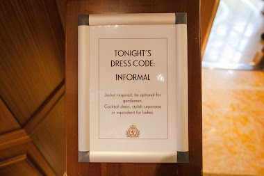 Signs aboard Queen Elizabeth let guests know about the dress code and when formal nights take place.