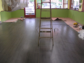 Photo: Can you believe how beautiful this is?! Our new, ceramic floor (that looks like wood, but wears even better for kitchen use).