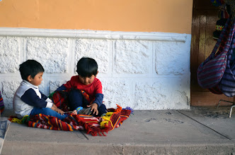Photo: Little kids playing outside their moms' shop