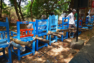 Photo: If you're too tired to walk the 300 steps you can be carried up in these chairs.