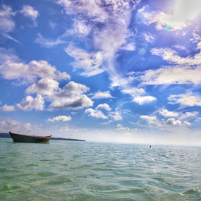 Cloudy Boat by Abhisek Datta - Landscapes Underwater ( clouds, boat )