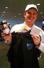 Photo: 2006-14 Executive Councillor Jason Huggins, P.E., models Tau Beta Pi merchandise.