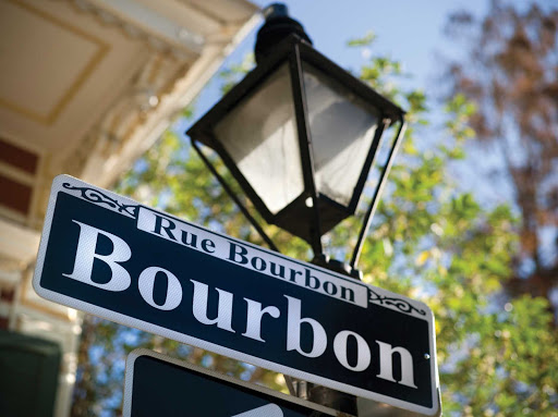 New-Orleans-Bourbon-Street-Sign.jpg - Cruise to New Orleans and enjoy the festivities and rows of drinking spots along Bourbon Street.