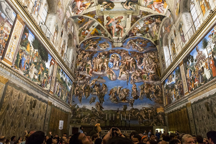 Tourists jostle for space in the Vatican's famed Sistine chapel.
