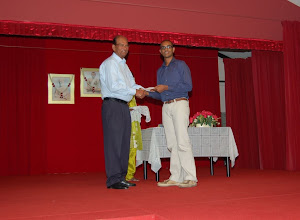 Photo: Arun Vignesh receiving the Excellece Award. He will be pursuing his degree in Economics at New York Univ.