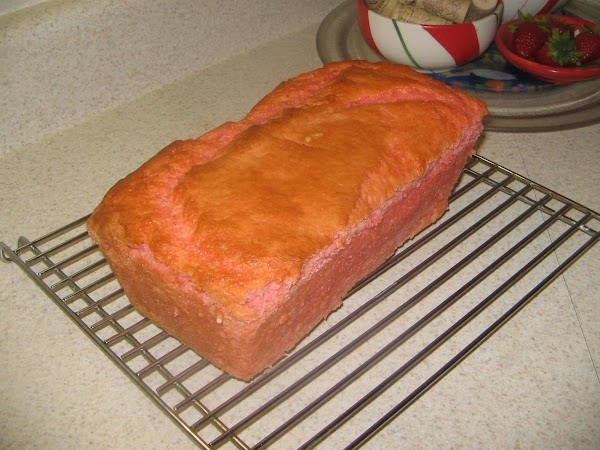 Run a knife around the sides of the pan and remove loaf from pan...