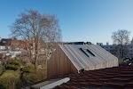 modern bijgebouw in verticale planken
