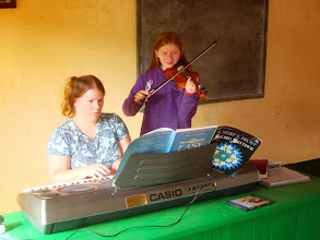 Photo: Kate, singing and playing her violin for special music in church.