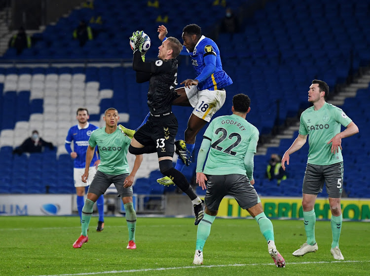 Everton's Robin Olsen in action with Brighton & Hove Albion's Danny Welbeck