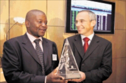NEW BEGINNING: Incoming Vodacom chairperson Peter Moyo with Vodacom chief executive Pieter Uys at the official listing of the cellphone giant on the JSE yesterday. 18/05/09. © Unknown.