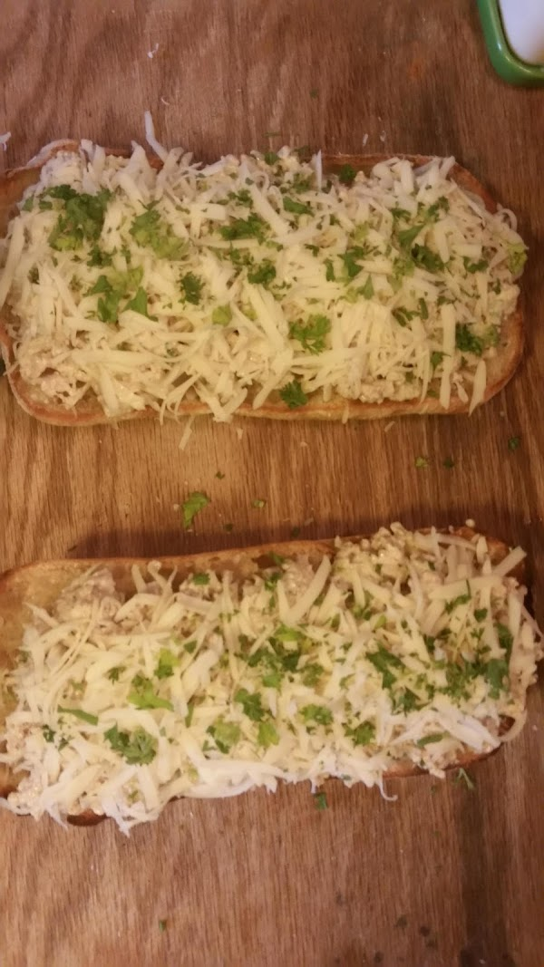 Place bread topped with chicken mixture on a baking sheet and bake in 400...