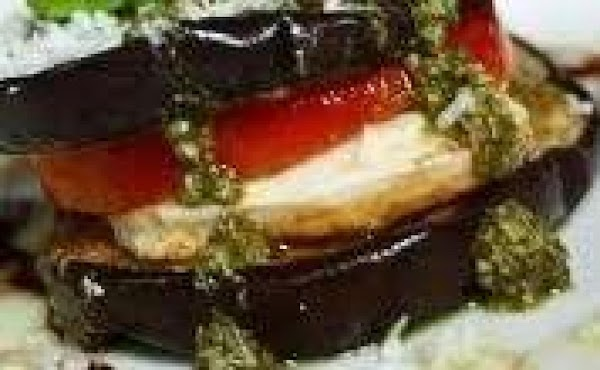Layer eggplant first, then tomato and cheese with fresh basil leaf inbetween top with...