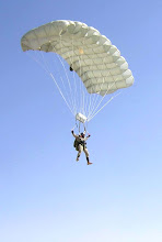 Photo: KANDAHAR AIR BASE, Afghanistan -- Senior Master Sgt. Paul Koester parachutes into the airfield here as part of a training mission.  Sergeant Koester is a 59th Expeditionary Rescue Squadron pararescuemen.  (Courtesy photo).