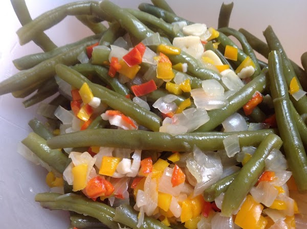 Using a slotted spoon remove green bean mixture from pot to a separate bowl...