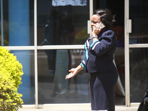 Kenya Women Parliamentary Association chair and Kirinyaga Women Representative Purity Wangui Ngirici talks over the phone in Parliament February 14,2018. /HEZRON NJOROGE